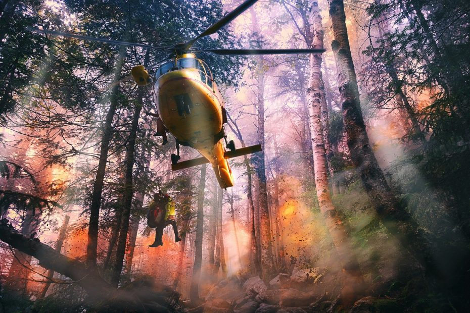 Helicopter putting out fires in forest
