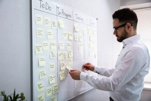 business man using a kanban board